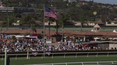 Flag at a horse racetrack Stock Footage