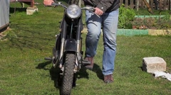 Man would try to start motorcycles Stock Footage