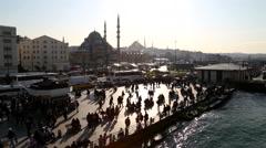 Crowd of Turkish people walking at sunset in Eminonu Square, Istanbul Stock Footage