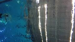 Underwater shot of man swimming backstroke at pool Stock Footage