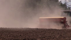 Dust rising from tractor fertilizer prepare soil in field Stock Footage