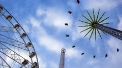 Amusement rides at a carnival - stock footage