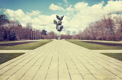 Retro filtered picture of municipal park, Szczecin. - stock photo