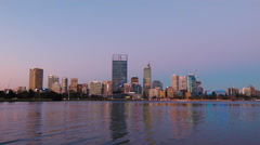 Perth CBD Skyline Reflecting On The Swan River After Sunset Stock Footage