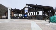 Administrative building of ski complex Alpika Service Stock Photos