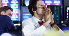 4K Financial traders in busy stock exchange celebrate making lots of money Stock Footage