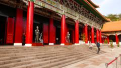 Main Shrine building entrance guards standing still in respect of the memory Stock Footage