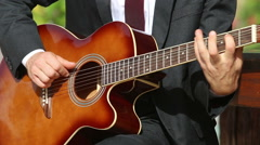 Bearded man plays guitar in different frets Stock Footage