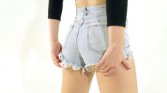 Close-up of shaking ass in denim shorts Stock Footage