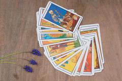 Cards of divination tarot with flowers Stock Photos