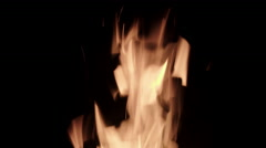 Flames burning against a black background 4K Stock Footage