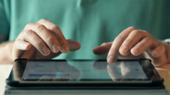Close-Up Typing On IPad Computer - stock footage