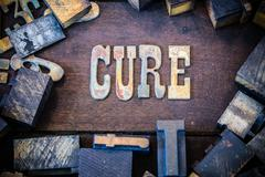 Cure Concept Rusty Type - stock photo