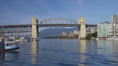 Granville Island Water Taxi Under Burrard Bridge - Vancouver Stock Footage