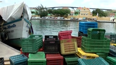 Curacao Willemstad 042 floating market with colorful empty plastic boxes Stock Footage