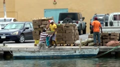 Curacao Willemstad 044 men load up boat with groceries for floating market Stock Footage