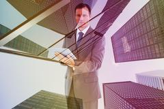 Composite image of serious charismatic businessman holding a tablet computer Stock Illustration