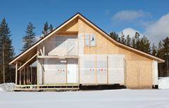 Construction cottage in the forest area Stock Photos