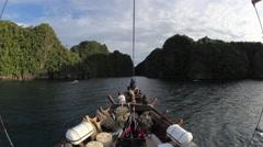 Indonesian Schooner and Limestone Islands Stock Footage