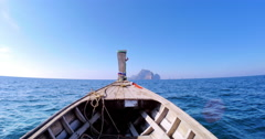Wooden fishing boat moves on sea at clean sunny day with blue sky Stock Footage