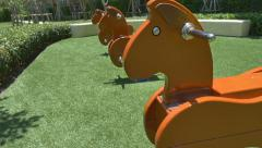 Seesaw in the shape of the horses for the playground - stock footage