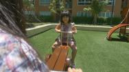 Stock Video Footage of Asian child playing at playground in a park