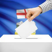Voting concept - Ballot box with national flag on background - Alberta Stock Photos