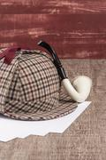 Sherlock Hat and Tobacco pipe Stock Photos