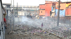View on street full of garbage during a train ride in Mumbai. Stock Footage