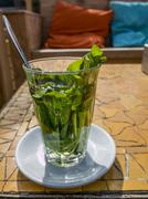 Fresh organic mint tea on a sunny terrace Stock Photos