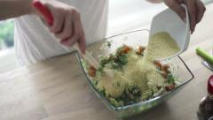 Woman mixing salad and adding couscous kasha, slow motion shot at 480fps HD Stock Footage