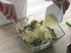 Woman mixing salad and adding couscous kasha, slow motion shot at 480fps NTSC Stock Footage