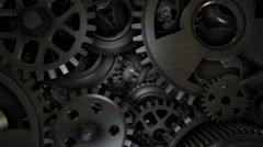 Big metal gears on glossy black background - stock footage