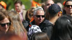 Man with crown in crowd Stock Footage