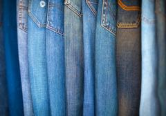 Blue-Jeans in Various Shades of Blue, Arranged on Display. Stock Photos