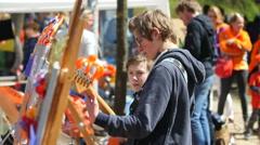 Boy guitar player at street fair Stock Footage