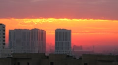Stock Video Footage of Dawn, morning, the sun appears from behind building.