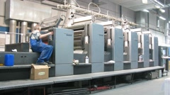 Two workers working in printing presses in Printing Complex - stock footage