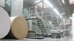 The equipment in the printshop, on floor are huge rolls of paper. Stock Footage