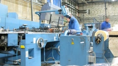 Workers work with machines that make binding. Stock Footage