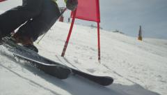 SLOW MOTION CLOSEUP: Slalom skiing between the gates Stock Footage