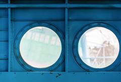Portholes inside the aircraft Stock Photos