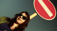 Attractive woman smile with abstract stop red sign - stock footage