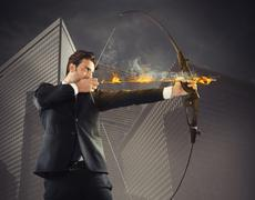 Businessman takes aim Stock Illustration
