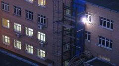Worker weld of the elevator shaft near the building at night Stock Footage