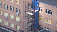 Worker weld of the elevator shaft near the building. Time lapse. - stock footage