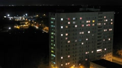 Turns on and off the light in the windows College at evening. Stock Footage