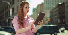 Young caucasian woman in city using tablet pc Stock Footage