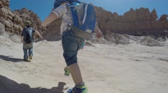 Families at hot Goblin Valley State Park southern Utah Stock Footage