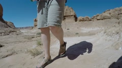 Family in hot Goblin Valley State Park southern Utah Stock Footage